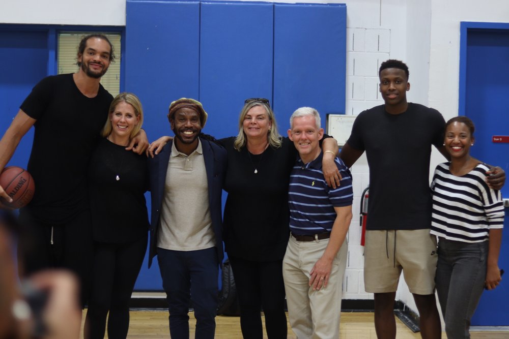 (L to R) Joakim Noah of the New York Knicks and Co-Founder of Noah's Arc Foundation; Anna-Claire Whitehead, Executive Director of Noah's Arc Foundation; Stanley Simon, Athletic Director of the Long Island City YMCA; Cecilia Rodhe, Co-Founder and President of Noah's Arc Foundation; Jimmy Van Bramer, Majority Leader of the New York City Council and Council Member for the 26th District; Frank Ntilikina of the New York Knicks; and Ebony Conely-Young, Executive Director of the Long Island City YMCA