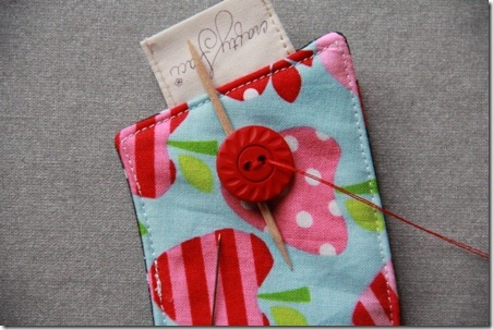 Sewing the button on a coffee cup sleeve - Crafty Staci