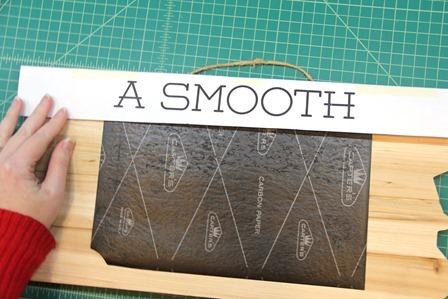Slide carbon paper under lettering