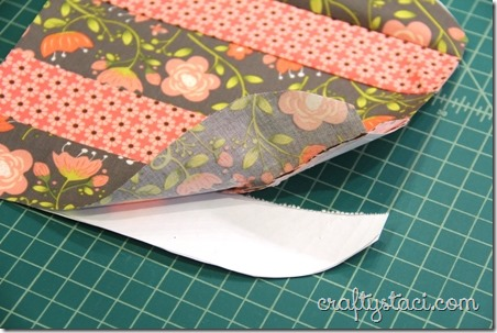 Tearing away the paper on umbrella hot pad