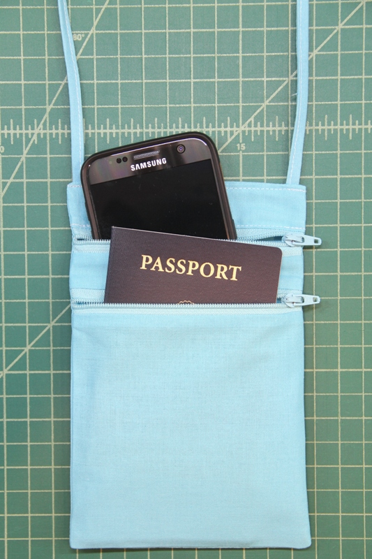 Passport bag with phone and passport.JPG