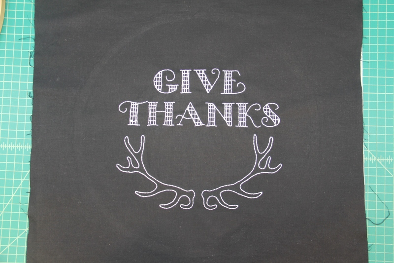 Words embroidered on Give Thanks hoop art