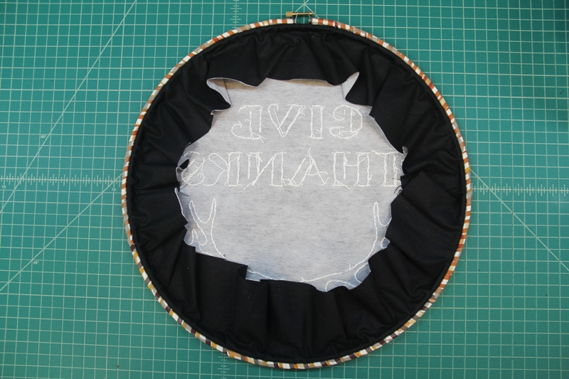 Folding in edges at back of Give Thanks hoop art