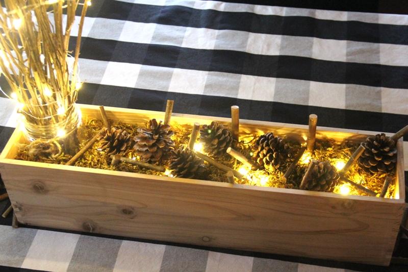 Adding pinecones and sticks