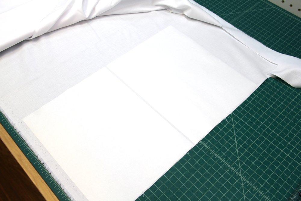 Iron freezer paper onto fabric