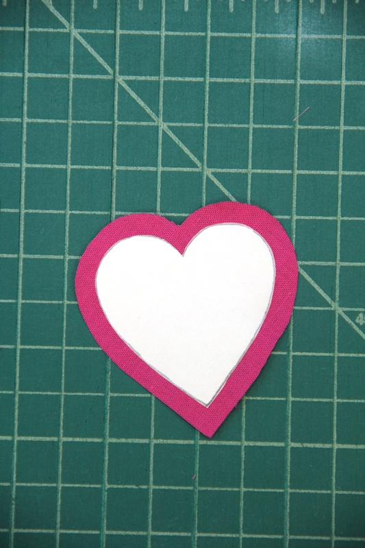 Iron paper heart onto fabric