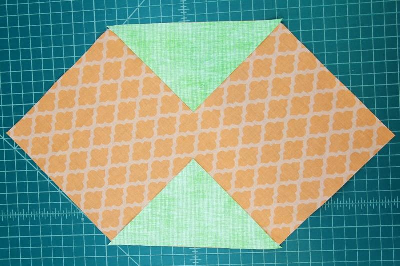 Stitch green triangles onto orange square