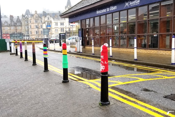 Yarn bombed posts in Oban Scotland