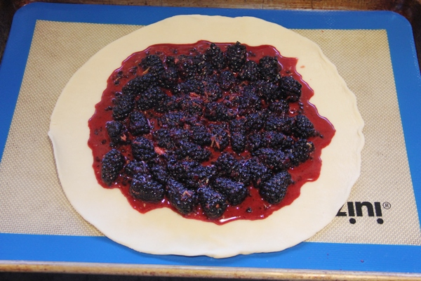 Spread berries on pie crust