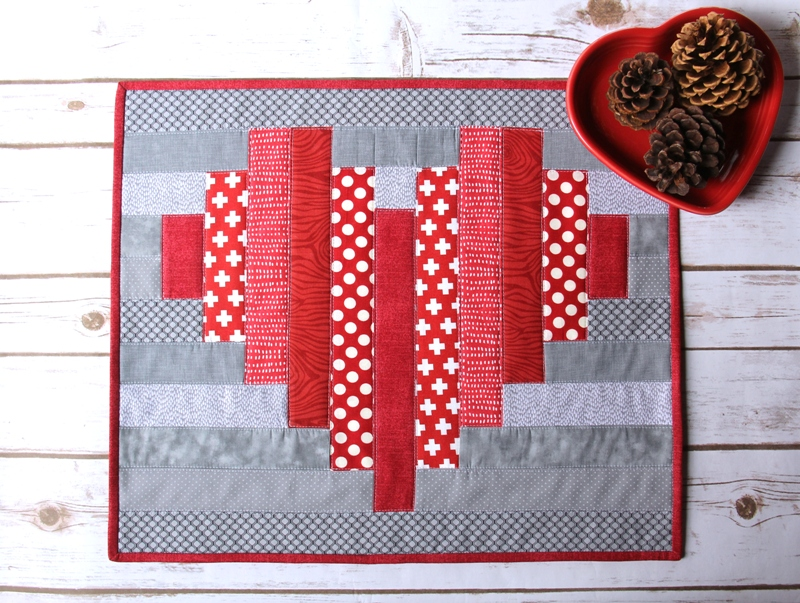 Striped Heart Mini Quilt on Crafty Staci #valentinequilt #valentinesewing #heartquilt
