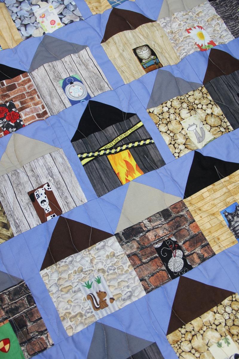 Pieced house on village quilt