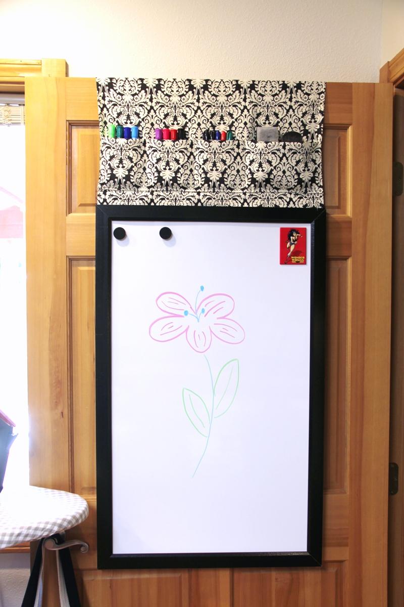 White board hanging on door.JPG