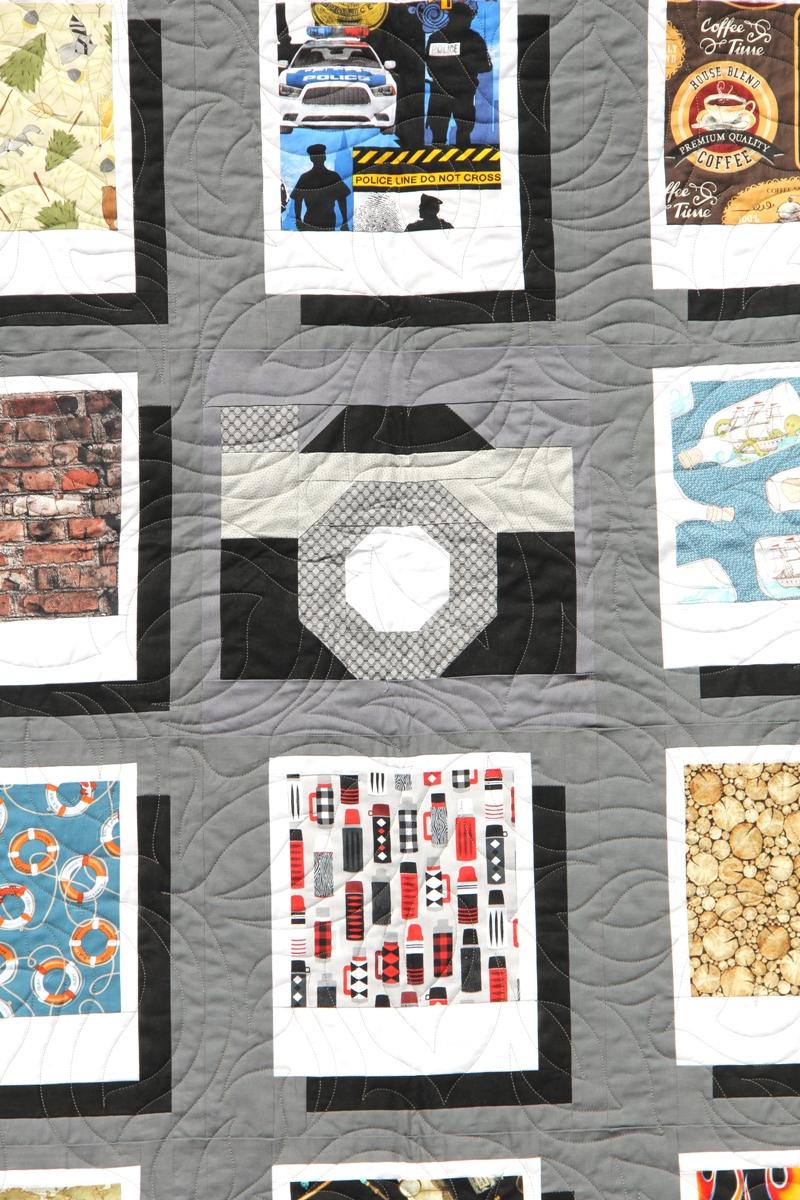 Paper pieced camera center square quilt block from craftystaci.com