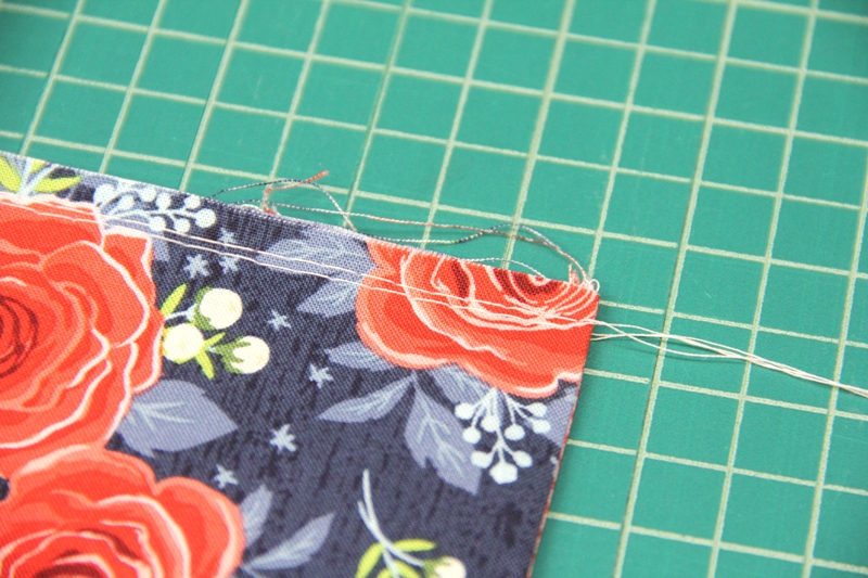 Sew two rows of basting stitching on apron with secret pockets