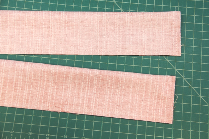 Stitch side and one end of tie for apron with secret pockets