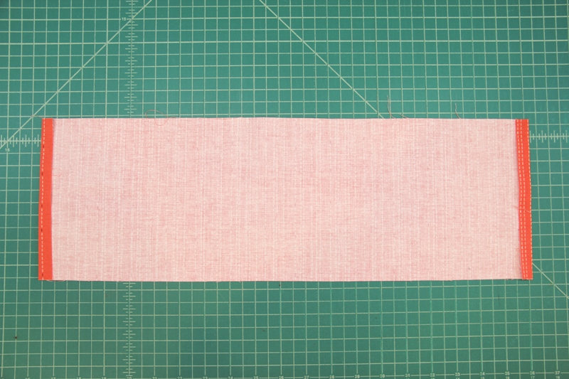 Press ends of waistband under for apron with secret pockets