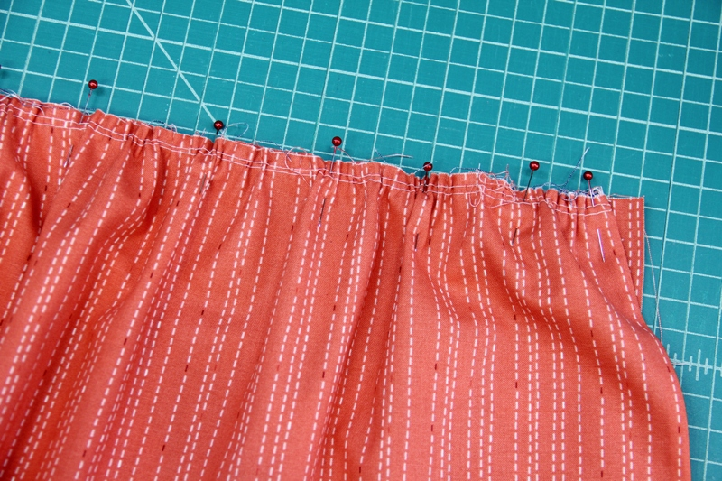 Pin skirt to waistband for apron with secret pockets