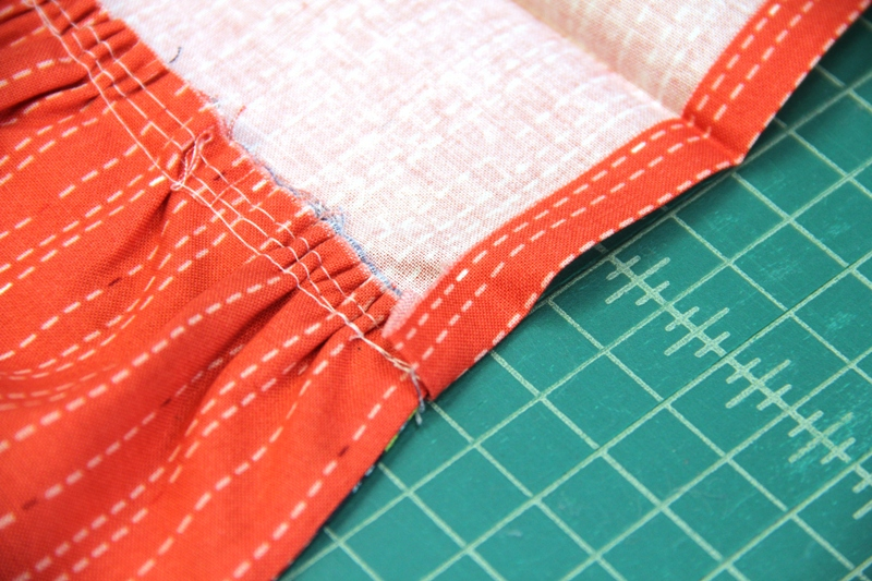 Fold ends back over skirt on apron with hidden pockets