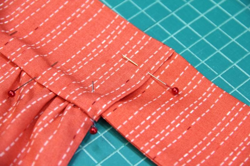 Tuck ties inside waistband on apron with secret pockets