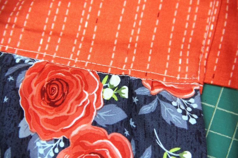 Stitch near edge of waistband on apron with secret pockets