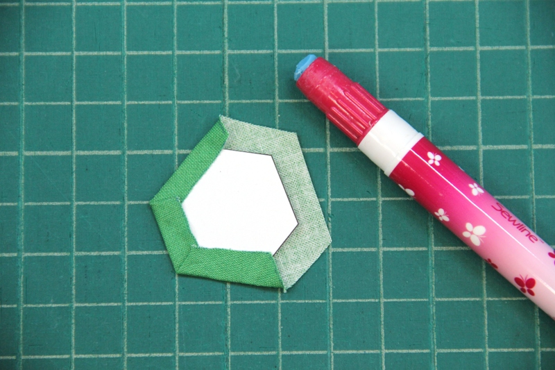 Gluing fabric around hexagon for fabric hexie earrings