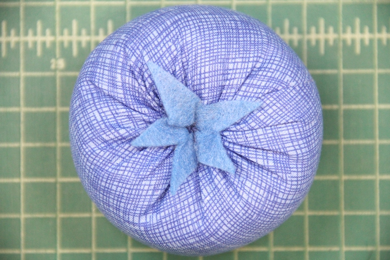 Stitch through top and bottom with felt top on blueberry pincushion