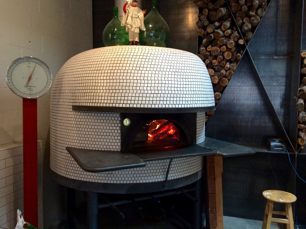 The Stefano Ferrara oven which was made in Naples, Italy, is such a beauty.I love the mosaic tile finish.