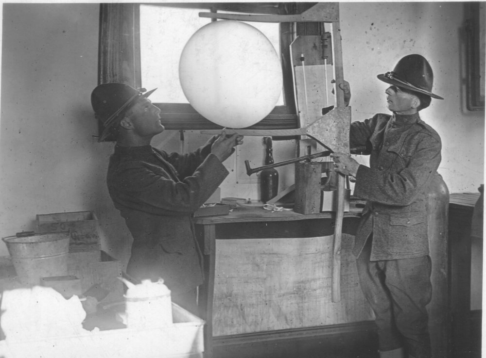 Privates Bly and Greening measure a weather balloon to ensure it is properly filled with hydrogen. Photo by A.W. Atkinson, US Army Signal Corps. Courtesy of the US Army Heritage and Education Center, Carlisle, PA.