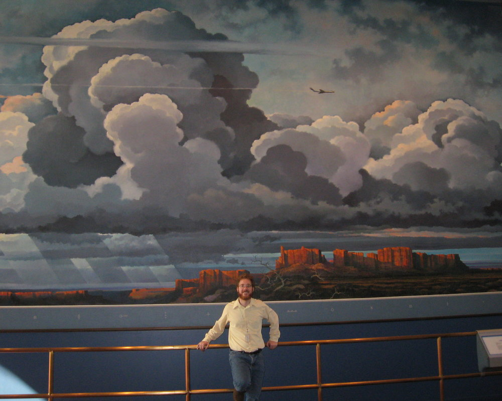 "That's me in front of Eric Sloane's mural ""Realm of Flight,"" at the Smithsonian National Air and Space Museum. (Photo courtesy of my mom.)"