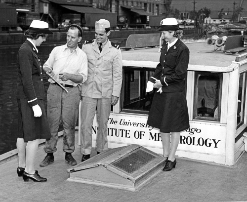 "The woman at far left is likely Maud Greenwood, learning about the University of Chicago's mobile meteorological laboratory onboard the ""Dude Fisherman,"" a 45-foot cruiser that sailed Lake Michigan. September 1943. Image Credit: University of Chicago Photographic Archive, apf3-02883, Special Collections Research Center, University of Chicago Library."