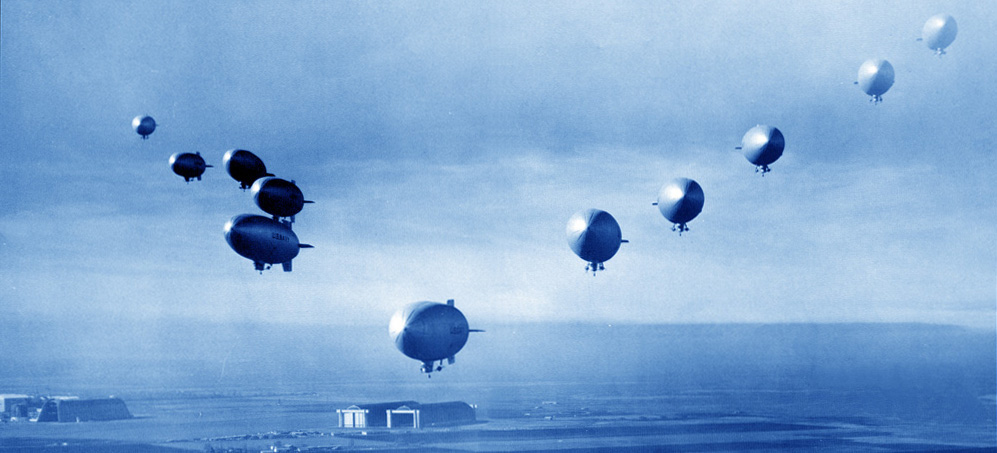 A squadron of anti-submarine blimps form up over Moffett Field during World War II. These long endurance aircraft needed careful meteorological support. I borrowed this image from http://www.warwingsart.com/LTA/zp-32.html, which credits the Moffett Field Historical Society.