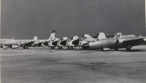 The Stormfury flightline. From right to left, a WB-57, five A-6s, and two DC-6s gravid with radar.