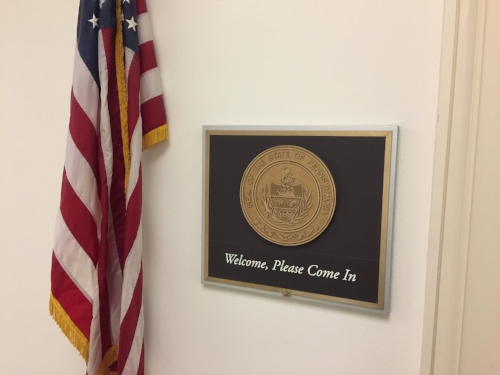 Every Congress person's door in the House Office buildings had one of these welcome sign posted below the state seal.