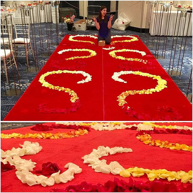 The lovely @rachellemcgonigal and @bridgettn working their magic on a Wedding set up @official_wem Fantasyland Hotel. Multi color rose petals were arranged in an ombré pattern to create this stunning walkway.  Florals @fleurs.flowers Wedding planner @chelsea_lawrie  Decor @rivercityevents
