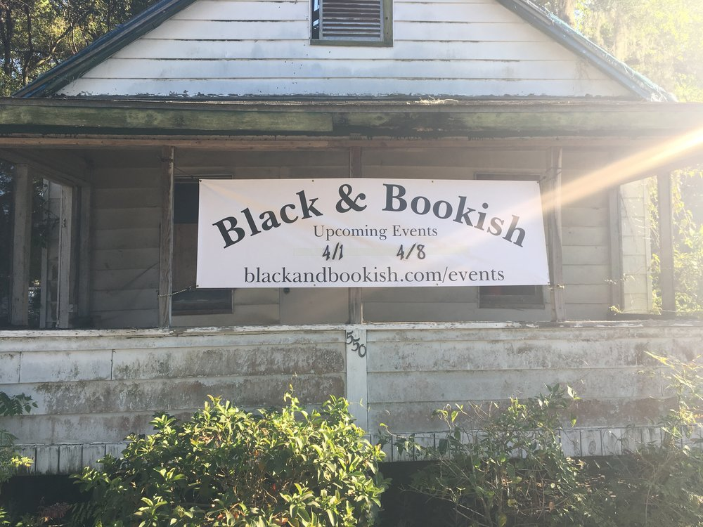 The Historic Thomas House with Black & Bookish Banner