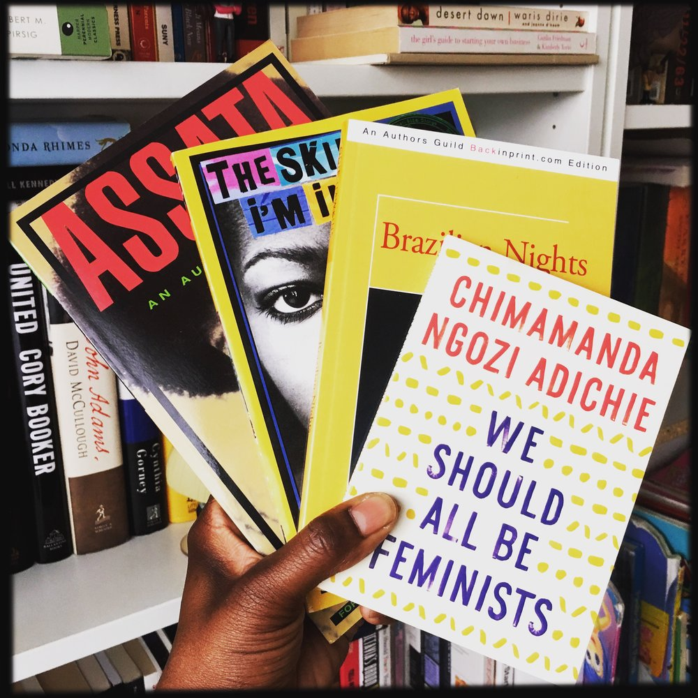 Four Black Books With Yellow Covers.JPG