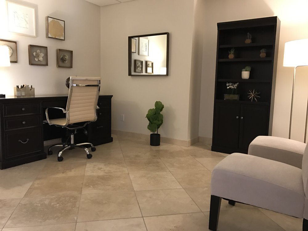 Psychiatrist office desk and chair with bookcase