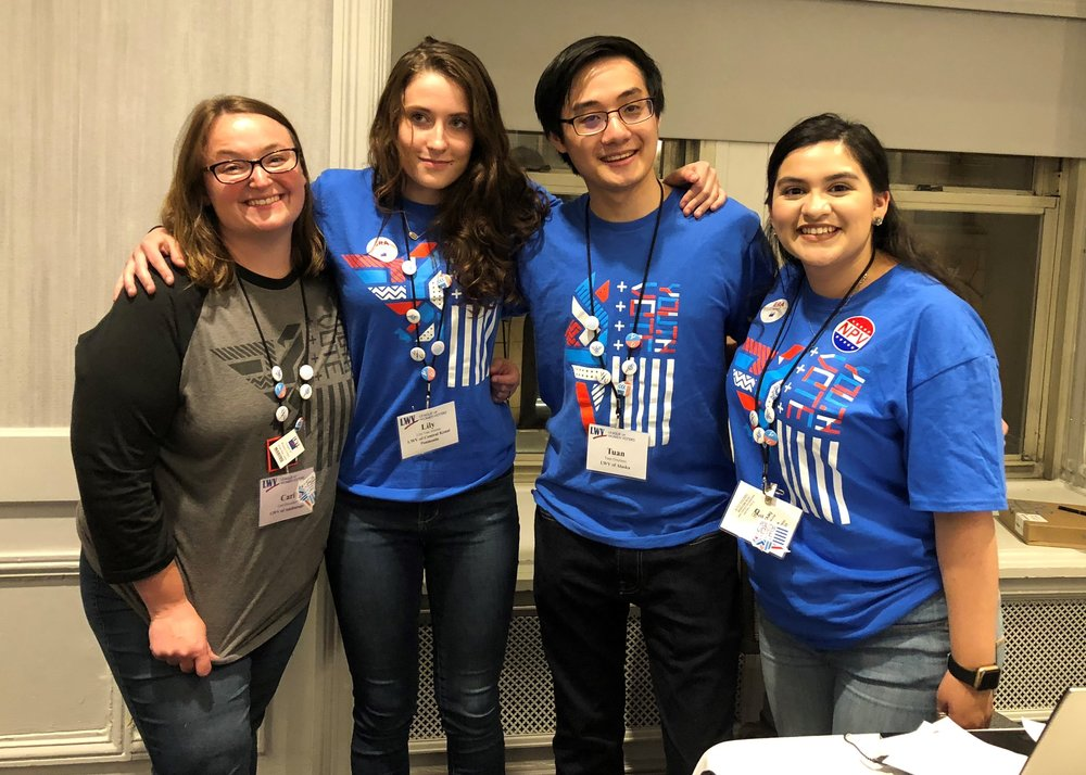 Youth Vote project presenters. To their left is the Executive Director. Two high school students flank a college student.  LWV of Anchorage, Alaska