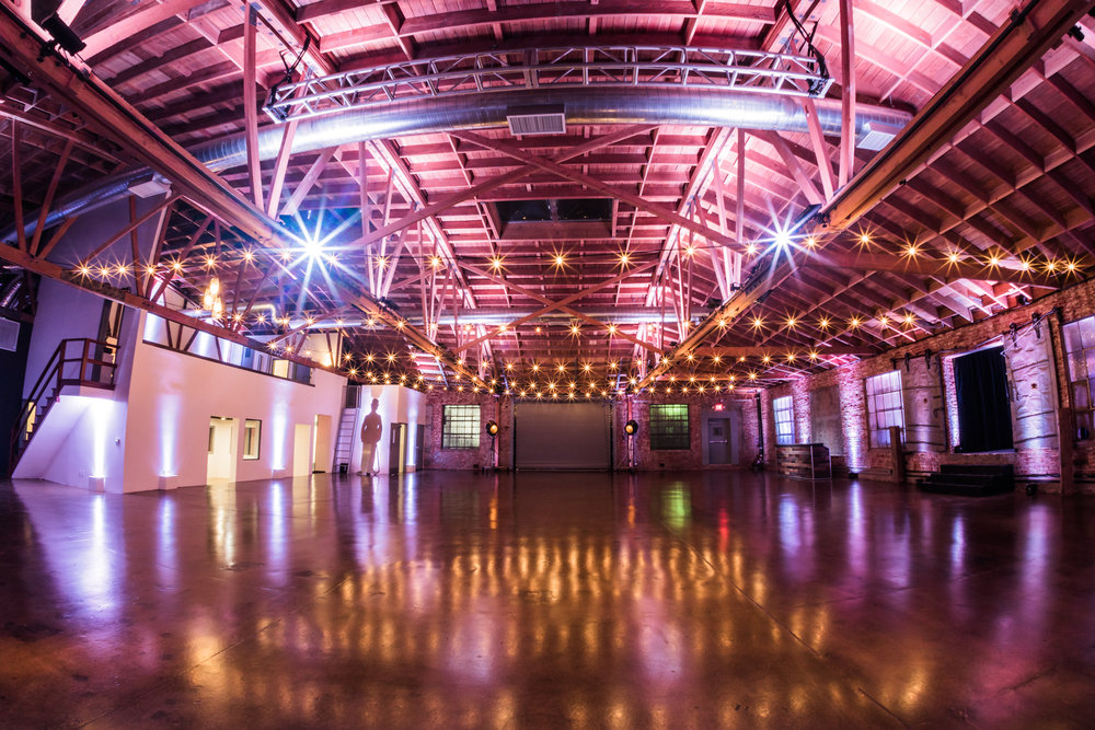 Factory Studio - The grand hall, Factory Studio is bathed in natural light from 5 massive skylights. A vast honeycomb aged wood bow-truss ceiling adds to the warm glow and spectacular visuals.  Sand blasted aged brick walls and a 20ft high hedge wall add to the texture and intrigue. All floors are polished with a warm gloss finish that sends light dancing throughout our venue.