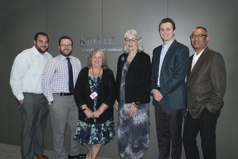 Left to right: Associate Mitchell Garnett, Associate George Stowe, Paralegal Suzanne Hoffman, Supervising Partner Janet Goelz Hoffman, Associate Andrew Herrington-Gilmore, and Paralegal Redentor [Denny] Magcalas.
