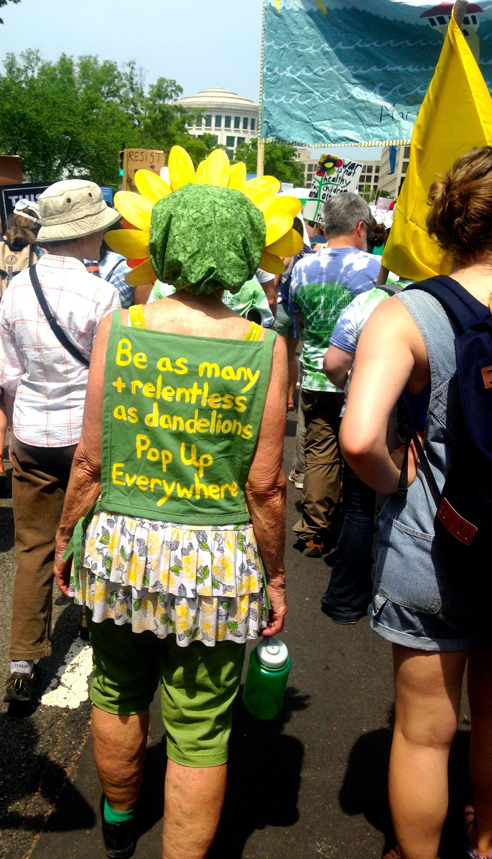 I loved this woman's handmade outfit and her message.