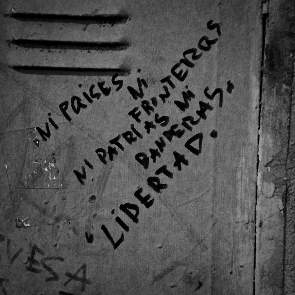 "Graffiti in Spanish, found on my last night when we spent the evening in Trastevere, my favorite neighborhood in Roma: ""Neither countries, nor borders, nor homelands, nor flags. Liberty."""