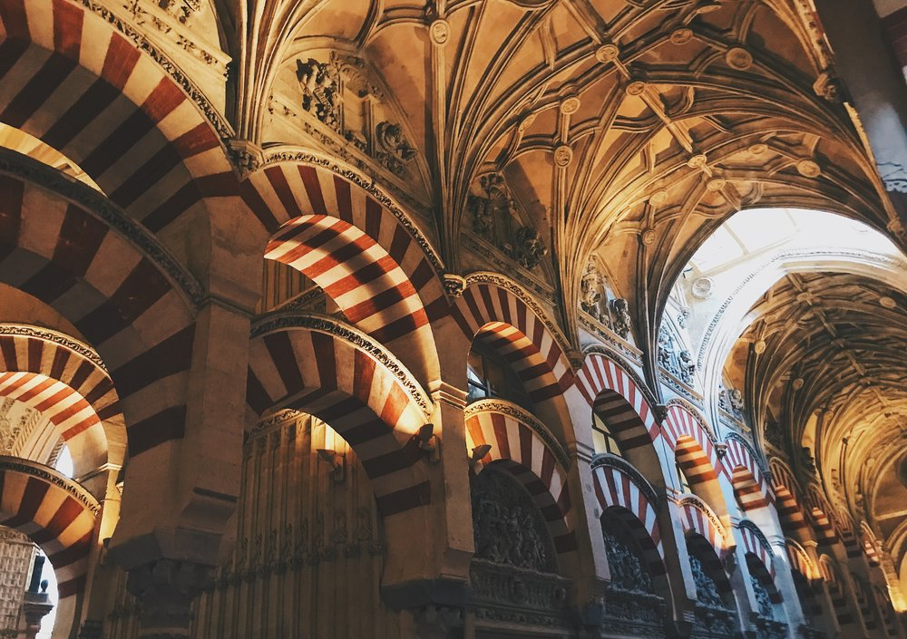 Inside la Mezquita-Catedral: you can see that a cathedral was literally constructed within the mosque. Christians destroyed most of the mosques in Spain with the Reconquista, but thankfully spared this one.