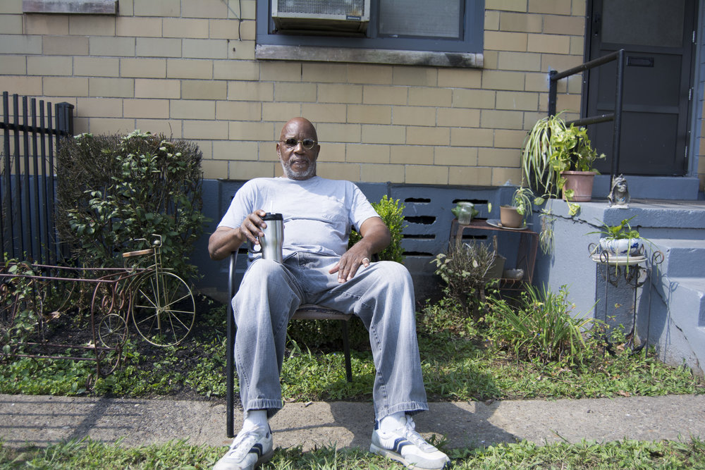 """""""I've been up here since October '89. You probably wasn't even born in '89. The biggest changes that I done seen, since '89, would be with the residents. Now, when I came up here in '89, the residents were more neighborly. You didn't have the issues and the problems with drugs and killings. I done seen a lot of changes. Since 1995, that's when I started to see the changes. When I moved up here, there wasn't no in between, it was just black and white. Now, you got Hispanics, you got Africans, you know, whatever. And then you've got all the different generations. It's different from when I first moved up here in '89. I can see it. These young people up here nowadays, man, they off the chain. Now, I lived back here, off this court, in 55 for about 25 years. I'm 70 years old. All the people that were down here, back in '89, either they moved or died, one of the two. Once that happened, that's when the new generation started moving in. I seen the change coming, just by the handwriting on the wall. Man, these ma'fuckin people are off the chain. They can't distinguish the right from wrong, or nothin else. They had me miserable back there, cause I didn't know what to do about it. It was an African lady, living right here, about 3 years ago. I was walking through this court, and I got right here. I looked over and she was sitting on the steps. She waved at me, every day. She would always say hi and I would smile. This day, I walked over to her and she told me that she was moving out. I went over to the rent office, that same day and told the lady that someone was moving out of 57 and could I get that. The lady said that she'll look into and guess what? I been here, ever since. They keep on claiming that they're gonna tear this damn place down. I'm like this, I ain't nowhere until I see the first brick fall down. I'm in, like Flynn. That's the documentary of the day. This right here is my empire. The other side is where my garden's at."""" - Michael D., Park Hill"""
