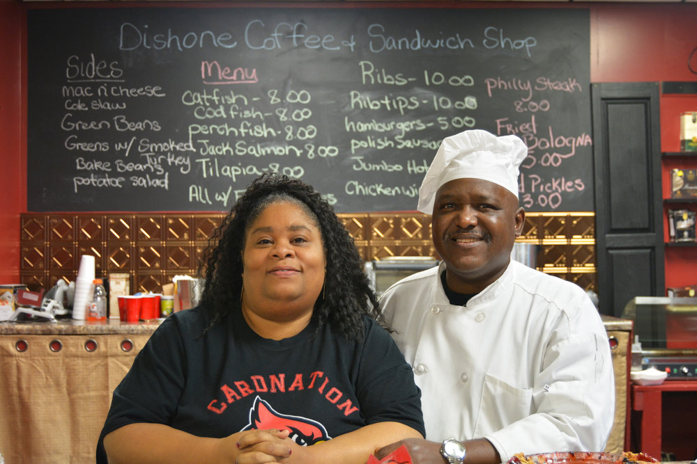 """""""The reason why we opened our business is because my husband was sick. He went into kidney failure. He lost his kidneys and then he recently received new kidneys two years ago. He was a chef for a long period of time. We decided to make the menu to cater to people who are on dialysis. They won't have to worry about their phosphorus being high. If you have kidney failure you can't eat potatoes and cheeses.  Then we found natural oils for different people with diabetes. I have neem and hemp seed oil and different stuff that you can used on your body that's healthy for you and all natural. I have black seed oil that's 2,000 years old and cures everything except death. You don't learn this in schools.  I worked as a nurse for 27 years. I used all my savings to get where I am today. I still got a long road butut God's brought me through all the struggles.  If you want to start your business, just do it. Don't procrastinate because you'll get older and then it's too late. You'll regret and you never want to do that."""" - Mr. & Mrs. Dishman, Russell"""