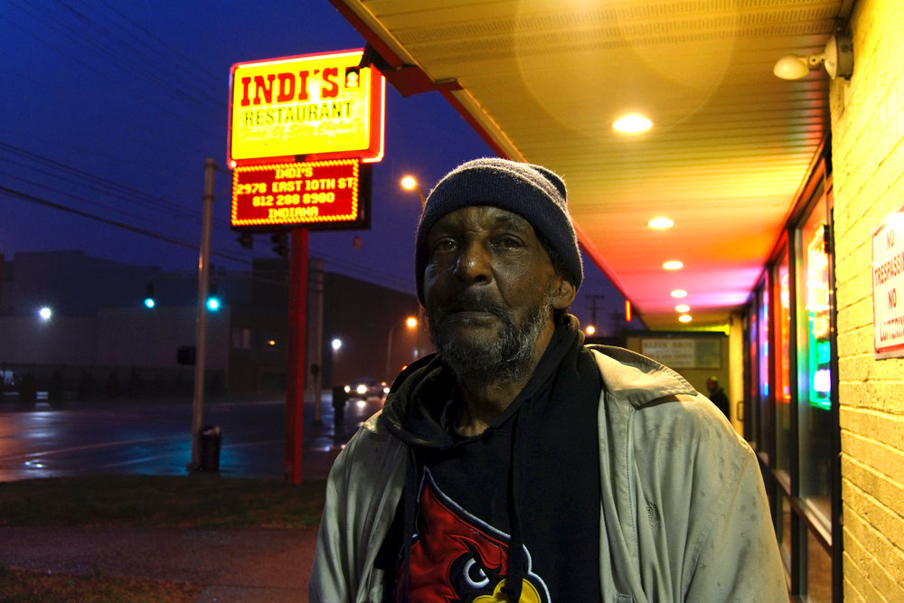 """""""Everything's bad, man. I'm having a hard time and I'm homeless and going through a time, right now. It's rough. I'm having to bum to get some change so I can get me something to eat.  I've lived in the West End all my life. I've seen Portland change from solid white to solid black. When it was solid white, you couldn't dare go to Portland. We couldn't cross Market Street and they couldn't cross Jefferson Street. It was a conflict. Now, Portland is mixed up and matches the other areas. I grew up around 38th and 39th on the other side of Market.  We need a shopping mall, more jobs, and a little more attention for the homeless."""" - Bryant, Russell"""