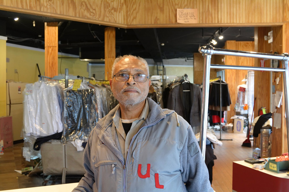 """My brother and I started in July 25th of 1969. We are from the country, from Hart County, Kentucky. My brother left home when he was 17 and went to Illinois and worked at a cleaners there. I think it was in Joliet, Illinois. He figured that he wanted to get into the dry cleaning business and he came back to Louisville in 1965. He and I got together and went to the Small Business Administration and applied for a loan and we didn't get the loan. In the meantime, in 1966, I went to dry cleaning school in Silver Springs, Maryland. I learned the intricate parts of dry cleaning. I learned everything from the spotting, the cleaning, the pressing, and even the customer service and customer relation. After that, I came back and worked with another gentleman for a couple of years. Then in 1969, we were able to get the SBA loan and we started in 1969. That was just about 50 years ago.  What inspired me to go into business in the early and late 60's was that there wasn't many African Americans in business, especially in the West End of Louisville, where predominantly African Americans lived. Some of the leaders in the community were reaching out to people to try to start businesses and to be an influence in the community. It just happened that my brother and I always wanted to be an influence and be in business, for ourselves and to help others. It's something that we dreamed and talked about, even as teenagers. We just happened to be at the right place at the right time because banks weren't lending African Americans money to go into business. I don't know if they felt that we weren't stable enough  or if there just wasn't enough money. After the riots, the federal government allocated for African Americans to get loans to go into business. We were blessed to obtain a loan.  The first location was a block south from here, before the renovation of this community. It was 3008 Wilson Ave. We were there for 38 years. We did our own work there. We moved over here in 2008.  I encourage young African Americans to go into business. Be prepared and find what your interests are and work at it. Go into business for yourself and for future generations. Prove that African Americans can do it with hard work, the help of the good Lord, dedication, and preparation. Be prepared for all you've got. Study and learn about the field you're going in. There's going to be challenges but if you have a hands on approach, you'll be able to figure it out. It requires hard work. That's helped sustained us.   The West End needs more services, like grocery stores. It needs manufacturing, maybe not big but even a small scale. The third thing would be a nice restaurant. You know, a nice sit down family restaurant, where we don't have to drive a far distance to get to. Oh, and the youth needs something on a different level where the average kid can get off the streets and play sports and do things academically. There's a lot of young kids with the knowledge and don't get the opportunity."" - Wayne Barbour, owner of Barbour Bros Cleaning, Park DuValle"