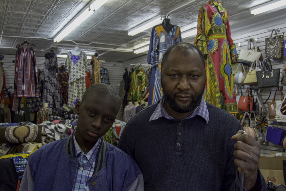 """""""I've been here since 1998. It's been twenty-one years. When I came here, I was the only business here. It was just me, Chevron and Kroger. I remember when I first opened up my business, the police used to be worried about me. At that time, there was a lot of crime over here. If I had a problem with the building and needed repairs, people would ask for my address and I would tell them 2015 West Broadway and they would tell me that they didn't come this far. That was just twenty years ago, not even a long time ago.  People were scared to come to the West End. Now, people are coming back to live here and the crime is lower. People are wanting to spend money and support black businesses. I think that if they do that, it'll help us and the community. We live here and we'll spend money here.  It's a lot of changes. When I first came here, it was rough and there was a lot of crime and lot of stuff. Things have changed. None of these buildings were here. It was a lot of empty lots. So, it's a lot of changes. I think with the new developments, they could do more. Even with the little things that they do, it would make some big changes.  For example, they were supposed to put Walmart over here and people fought. Walmart would have been good. It could have brought a lot of people from a ten mile radius. With Passport, I don't know. I hope they hire people from the West End. They said that they were gong to hire five hundred people. I hope it's not going to be a bunch of people, from outside, that will just come to work and go home. We're not going to benefit from it. The YMCA will be good for the neighborhood. The director said that he's going to make sure that every kid knows how to swim, so that's good. That'll be a positive thing for the neighborhood.  I think the West End is headed in a good direction, if they let us do more. We have to come together and do more instead of complaining. For example, they complained about Walmart. Now, Walmart's gone and what do we get? We """