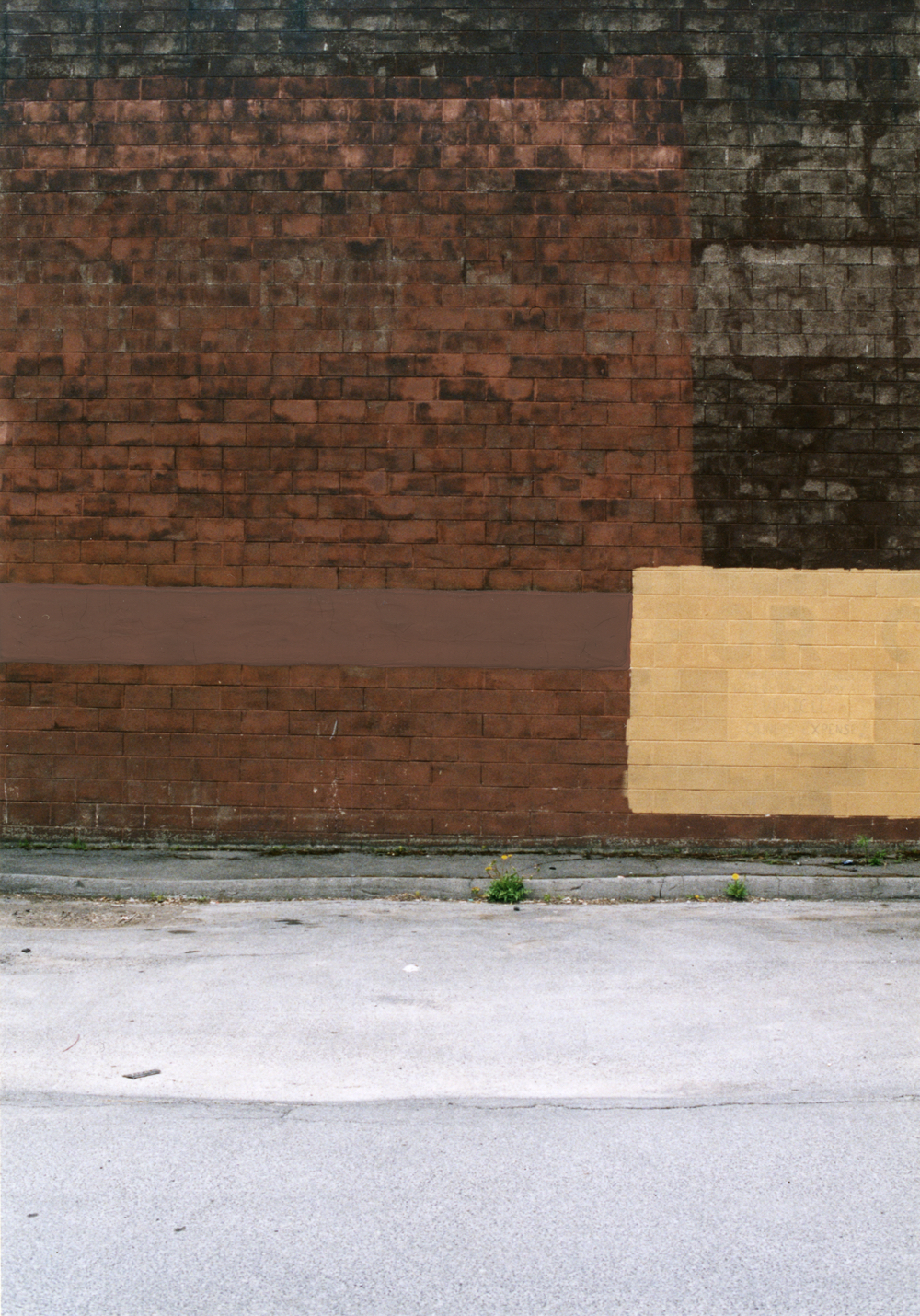 Erasure (black red brick wall peach sign pavement)