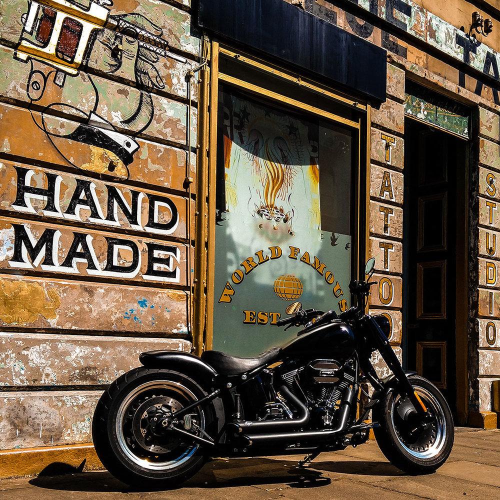 Badass bike outside badass tattoo studio